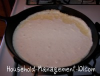 cornbread batter in iron skillet