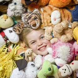 buried in stuffed animals