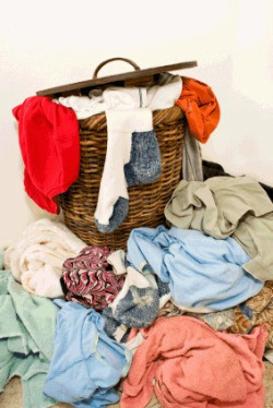 wicker laundry basket overflowing with clothes